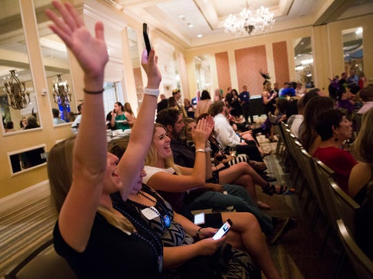 Rachel Forbes, Stacy Graison and Kelsey Burr, with the Naples Zoo, cheer as the zoo wins an award during the Choice Awards presented by the Naples Daily News on Thursday, July 27, 2017, at the Naples Grande Beach Resort.