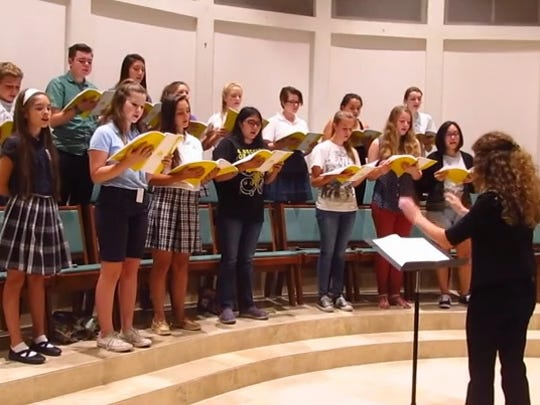 Maddie Barrett, a senior at Desert Mountain High School, directs the Pueri Cantores youth choir at St. Bernard of Clairvaux Catholic Church in Scottsdale.
