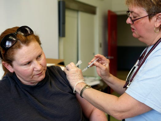 Supervising public health nurse Carole Van Nahl administers an immune globulin shot to Debra Mulholland of Ridgefield Park, NJ April 12, 2014 at the Fire Training Center in Pomona. Rockland Department of Health is offering free hepatitis vaccines for people who ate at La Fontana restaurant in Nyack after possibly being exposed to hepatitis A by a worker who had the disease. Immune goblin is preferred for those over 40-years-old. The couple ate at the restaurant with their son, who lives in Nyack.