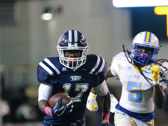 Jackson State tailback Jordan Johnson runs away from a Southern defender Saturday night at Memorial Stadium