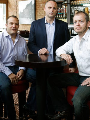 Four Entertainment Group managing partners Bob Deck, from left, Ben Klopp and Dan Cronican at the Lackman Bar. Their new bar, Low Spark, could open in February at 14th and Republic.