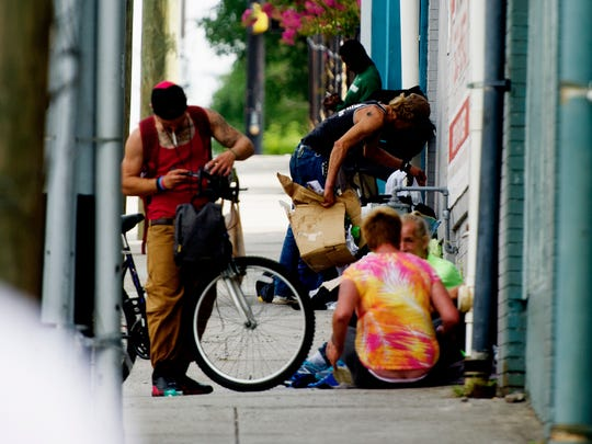 Homeless outside of Knox Area Rescue Ministries, 418 N Broadway, in Knoxville, Tennessee on Saturday, July 8, 2017. Since the age of 10, Nick Bryant, now 15, has been asking for cases of water instead of presents to donate to KARM.