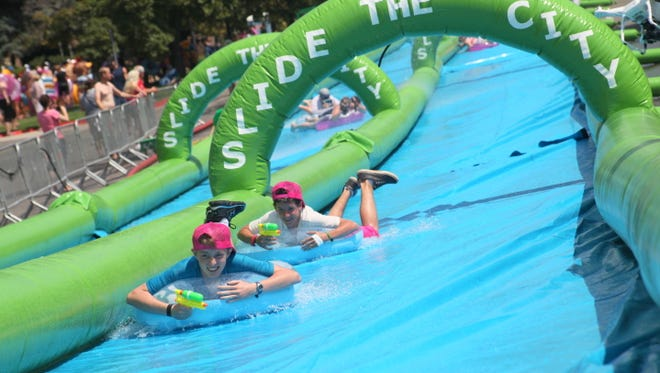 Slide the City, which began last year, has two events coming up, in Fountain Hills this weekend and in downtown Phoenix next month.