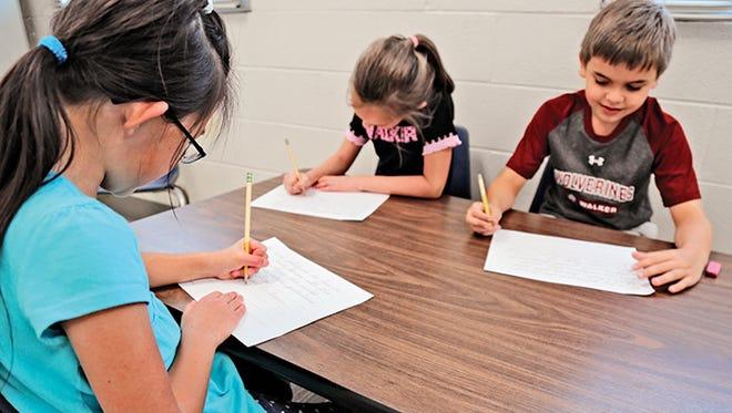 Second-graders practice their cursive skills at The Walker School in Marietta, Ga.