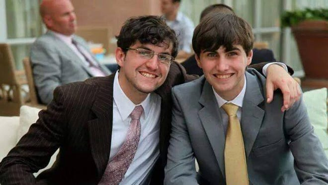 Alexander Pannizzo, right, poses in a photograph as his older brother, Joseph, puts his arm around him at a family wedding in 2013.