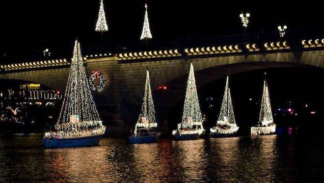 The Boat Parade of Lights goes under London Bridge in Lake Havasu City.