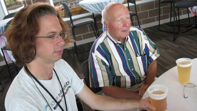 John Pemble of Iowa Public Radio, left, and philanthropist Richard Jacobson enjoy a post-interview beer at the 2010 Iowa State Fair that marked the opening of the new Richard O. Jacobson Exhibition Center. Jacobson died April 1 at age 79.