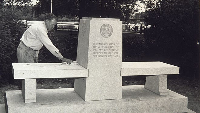 This 1949 photograph shows the war memorial monument in Shattuck Park.
