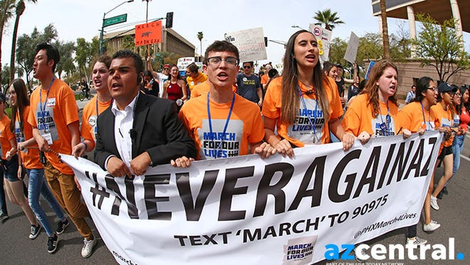"March For Our Lives protesters demand ""their lives and safety become a priority and that we end gun violence and mass shootings in our schools and communities"" march to the Arizona State Capitol on Mar. 24, 2018 in Phoenix, Arizona. After the rampage at Marjory Stoneman Douglas High School in Parkland, Florida, left 17 people dead, a student lead movement has spread across the country seeking changes to gun regulations, school safety and registering new voters."