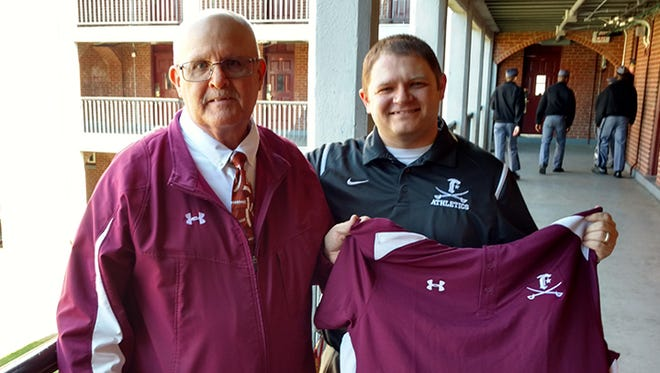 Tom Goforth (left) is in his first year as Fishburne's head football coach. The longtime coach is worried about the future of football after three schools in Virginia dropped their varsity programs in recent weeks.