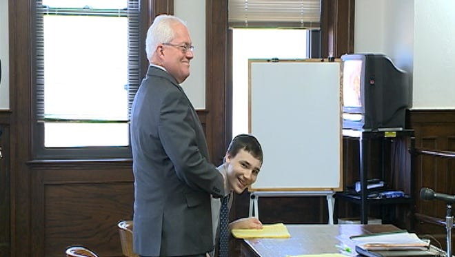 Cody Metzker-Madsen and his defense attorney, Michael Williams