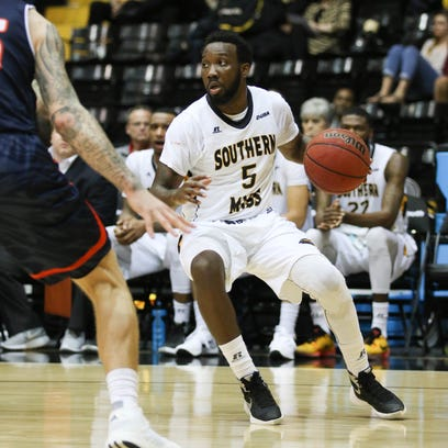 Southern Miss guard Khari Price (5) dribbles the ball