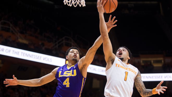 Tennessee guard Lamonte Turner (1) attempts a shot past LSU guard Skylar Mays (4) during Tennessee's home basketball game against LSU at Thompson-Boling Arena on Wednesday, January 31, 2018.