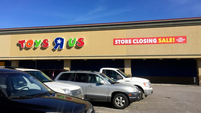 A sign outside a Toys R Us store in Greece, NY announces the store's closing.