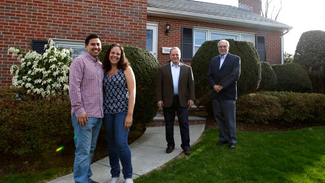 Levy, left, and Jadera Garcia bought their first home with the help of Gary Slutsky, right, and Gary Herbst, realtors with Buyer's Edge Realty, Inc. They are photographed April 30, 2015 in White Plains.