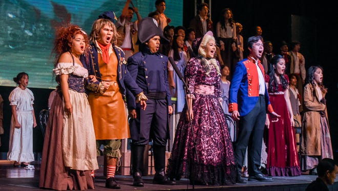 Cast members give a sample performance of Les Misérables School Edition Guam during a press conference at the Father Duenas Memorial School's Phoenix Center in Mangilao on Tuesday, Oct. 10, 2017.