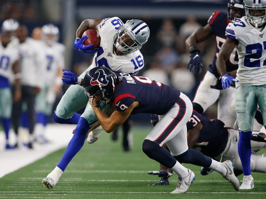Dallas Cowboys wide receiver Ced Wilson (16) is tackled by Houston Texans punter Bryan Anger (9) in the second quarter at AT&;T Stadium. Tim Heitman-USA TODAY Sports