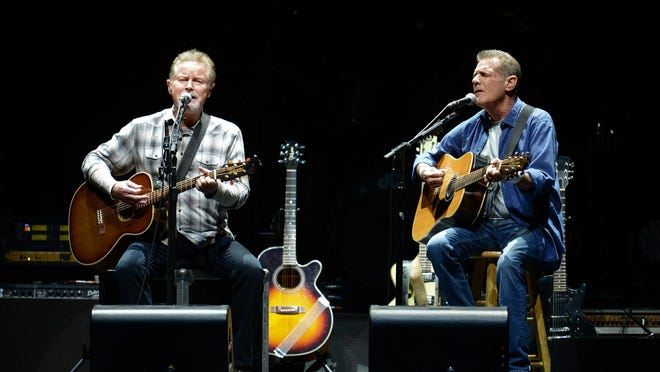 "Don Henley, left, and Glenn Frey perform during the ""History of The Eagles"" Tour Sunday at the Resch Center in Ashwaubenon."