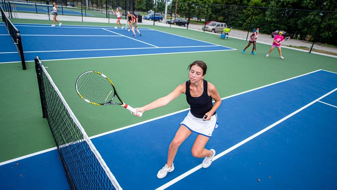 Blue Springs South senior Ella Weir works out on the new courts at Young Park next to the high school Tuesday morning. The Jaguars are preparing for their 2020 season on a brand new set of courts after the park was renovated this summer.