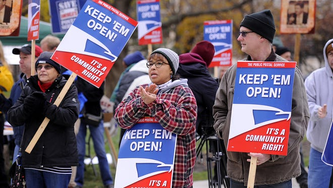 U.S. Postal Service employees and supporters rally at the Capitol earlier this month to protest the planned closing of the Collins Road processing facility. The writer says the closing plan lacks common sense.