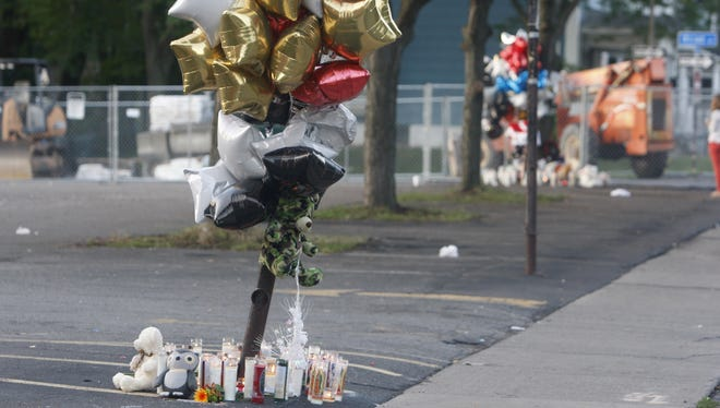 Memorials for Jonah Barley and Raekwon Manigault were erected where they were shot in August on Genesee Street.  Another man, Johnny Johnson, was also fatally shot in a drive-by in the parking lot at the Boys & Girls Club of Rochester.