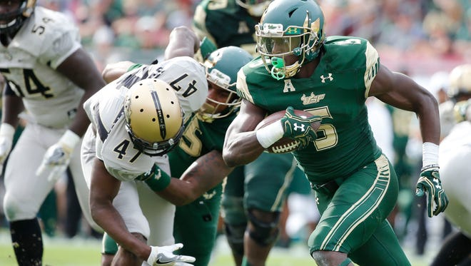 South Florida Bulls running back Marlon Mack, who signed with the Colts on Wednesday, runs during the second half at Raymond James Stadium. South Florida Bulls defeated the UCF Knights 48-31.