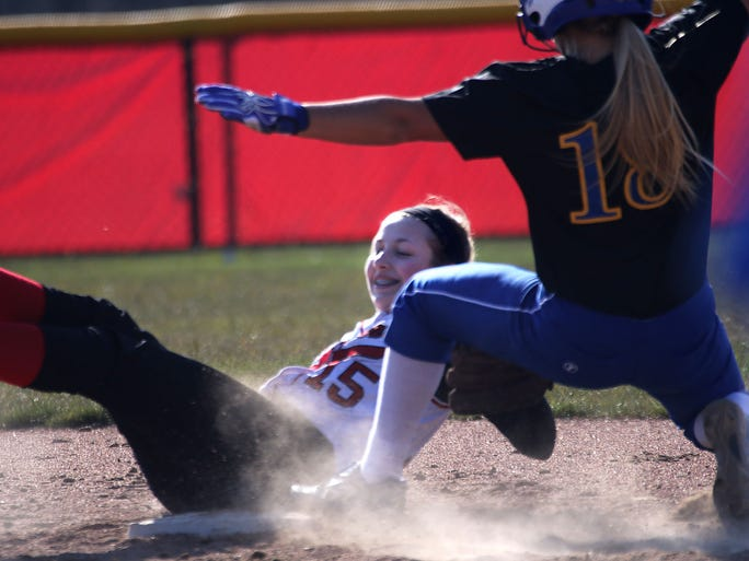Homestead's Kacie Gross (15) attempts to tag Germantown's Amanda Williams out at second base  during the teams game at Homestead High School Friday, April 16, 2016, in Mequon, Wisconsin.