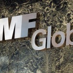 File photo taken in 2011 shows an MF Global Holdings sign in the New York City office building where the now defunct brokerage once had its offices.