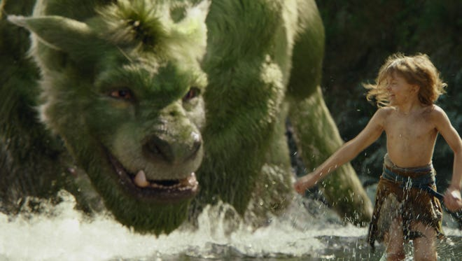 """This image released by Disney shows Oakes Fegley in a scene from """"Pete's Dragon."""""""