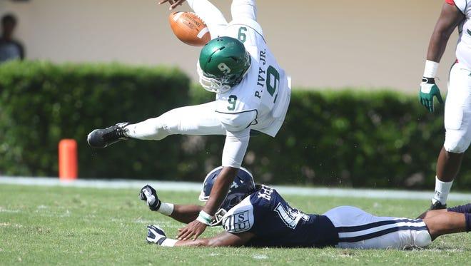 MVSU QB Patrick Ivy fumbles after being struck by JSU defender Ariane McCree, Saturday, October 11, 2014 in Jackson, Miss. (Charles A. Smith/JSU)