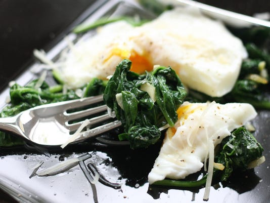 Poached Eggs with Garlic Wilted Spinach and Parmesan