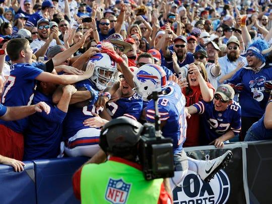 Buffalo Bills tight end Logan Thomas celebrates his