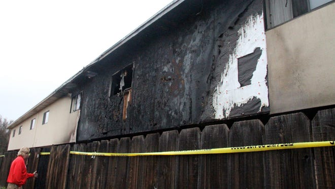 Property Manager Larry Mitchell surveyed damage done by a fire at Cielo Vista Apartments on Thursday.