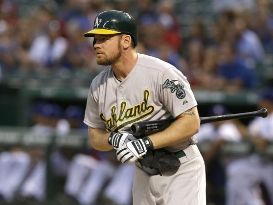 Oakland Athletics Brandon Moss reacts to striking out during the first inning of a baseball game against the Texas Rangers in Arlington, Texas, Friday, Sept. 26, 2014. (AP Photo/LM Otero)