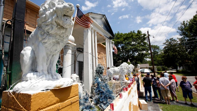 Visitors line up to see the eclectic collection of photos, records, albums and knick-knacks collected by the late Paul MacLeod, an Elvis-obsessed man who turned his antebellum home into the offbeat museum called Graceland Too.