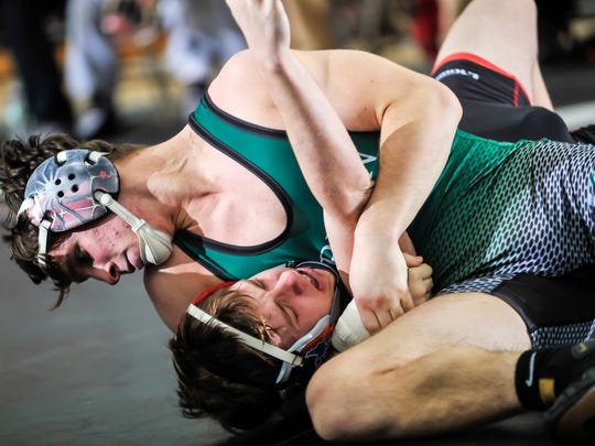 Anthony Aquilano of Raritan, top, works toward a pin of PJ Soldano of High Point in their 160-pund bout in the NJSIAA finals in Toms River on Feb. 11, 2018.