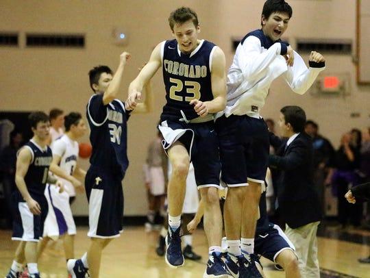 The Coronado boys basketball team celebrates after