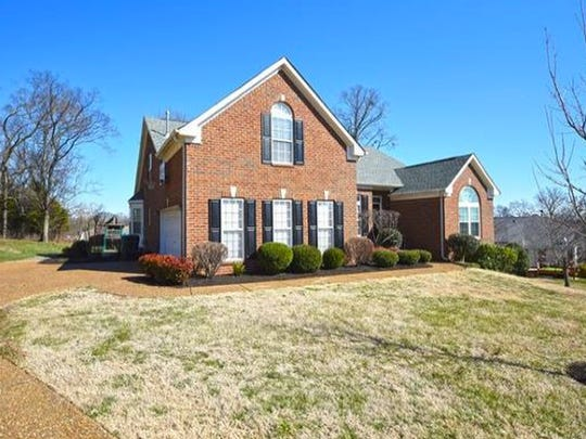 This Nolensville home has three bedrooms on the main level and one bedroom and a bonus room upstairs.