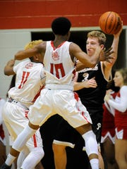 Bosse's Jaidon Hunter (11) and Bosse's Kyrique Presley (10) guard Boonville's Ben Meier (3) during their game at Bosse High School in Evansville, Friday, Jan. 20, 2017.