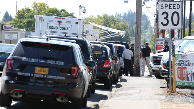 Salem Police Bomb Squad investigate a suspicious package left at the U-Haul location on 12th Street SE on Thursday, Sept. 8, 2016.