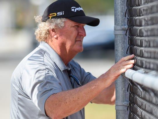 Martin County tennis coach Skipper Morgan watches his
