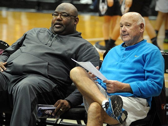 Nick Purnell and Wi-Hi head coach Butch Waller take in a game at the 36th annual Governor's Challenge on Thursday, Dec. 29, 2016 at the Wicomico Youth and Civic Center.