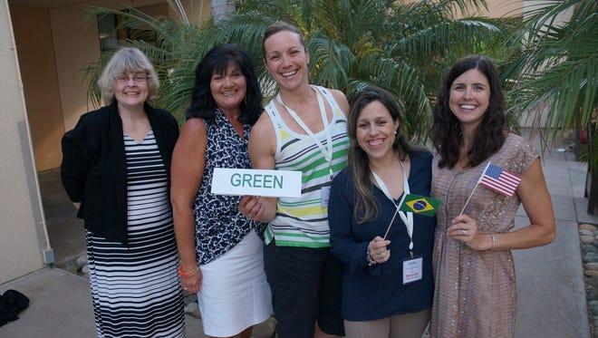 Dennie Glenn (left), a teacher at Roxbury High School, with Julie Ruziska Tiddy, Nicole Keegan, Caroline Santos and Amanda Figolah, participate at Honeywell Green Boot Camp.