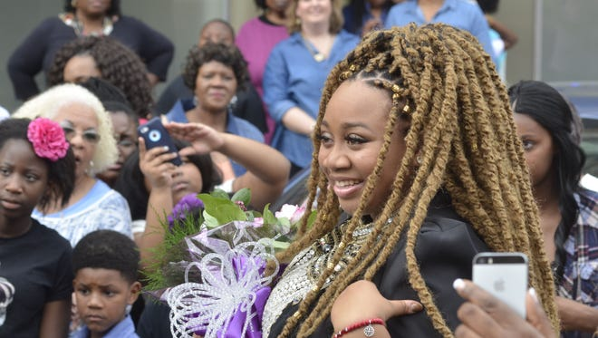 American Idol contestant La'Porsha Renae greets fans at the beginning of a parade in her honor in her hometown of McComb on Saturday.