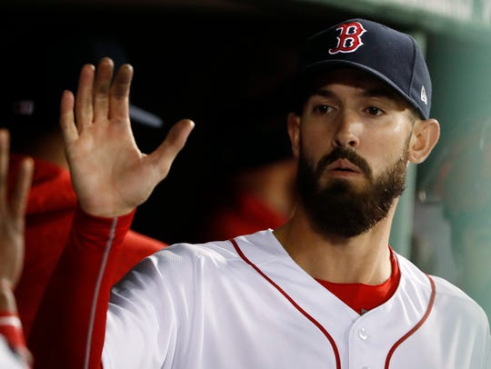 Boston Red Sox starting pitcher Rick Porcello is congratulated