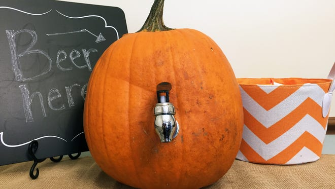 Turn a pumpkin into a dispenser for beer or your favorite fall beverage.