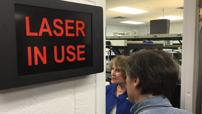 Rep. Louise Slaughter tours a laser lab at the University of Rochester.