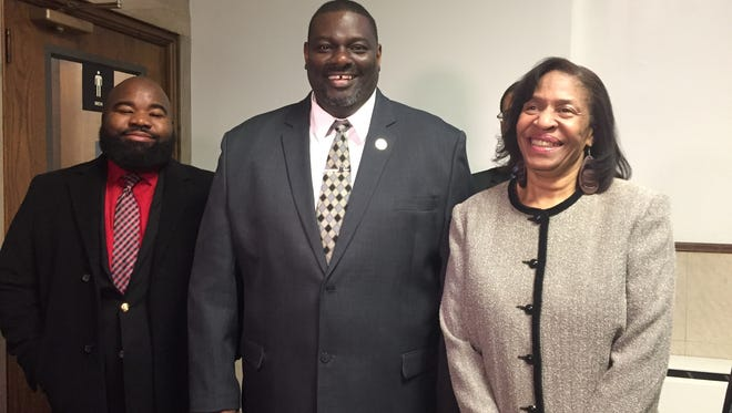 State Rep. Marcus Hunter (left) represented Monroe City School Board member Daryll Berry in court. Hunter, Daryll Berry and Seretha Berry celebrated a petition to remove Berry from office being dropped on Thursday after a court hearing.