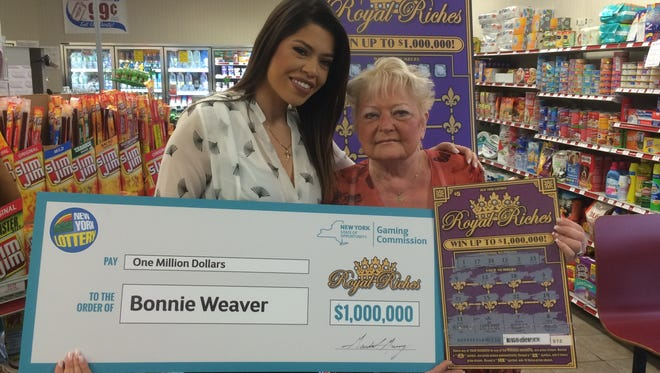 Bonnie Weaver, right, is pictured with New York State Lottery personality Amanda Serrano at the Stewart's Shops store in Fishkill Plains. Weaver, a 61-year-old Hopewell Junction resident, won the $1 million prize on a Royal Riches scratch-off ticket.