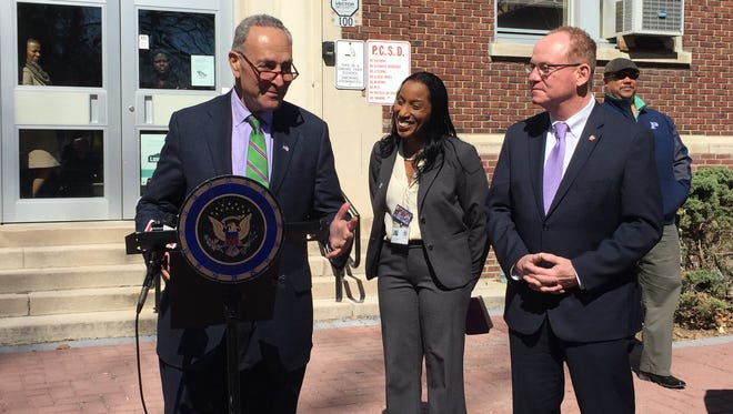 New York Sen. Chuck Schumer, alongside Nicolé Williams, superintendent of the Poughkeepsie City School District, center, and Poughkeepsie Mayor Rob Rolison, right, announces new legislation to fund lead testing in schools and daycare facilities.